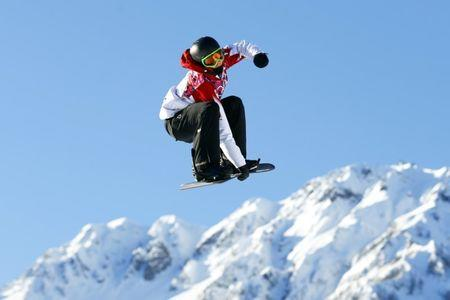 Canada's Mark McMorris performs a jump during the men's snowboard slopestyle competition at the 2014 Sochi Olympic Games in Rosa Khutor