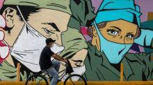 Britain eases virus quarantine as US under siege