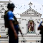 Suspects in Easter Sunday bombings in Sri Lanka still at large, may be carrying explosives
