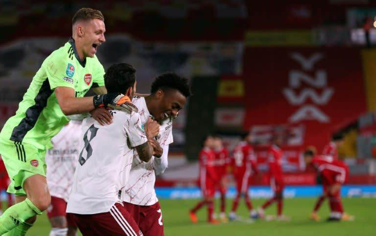 Arsenal goalkeeper Bernd Leno (L) celebrates with Joe Willock (R)