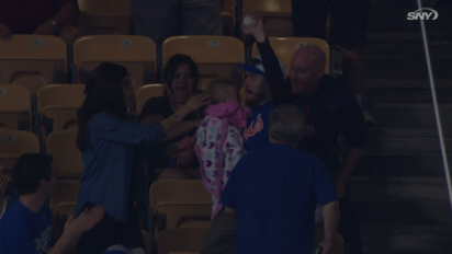 Mets fan catches foul ball, nearly drops baby