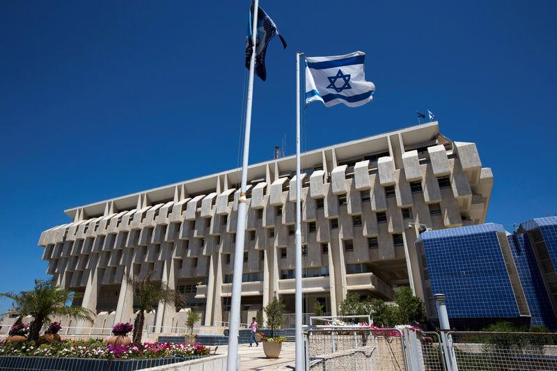 An Israeli Flag Flutters Outside The Bank Of Israel Building In Jerum