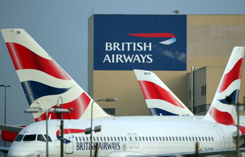 FILE PHOTO: British Airways aircraft are seen at Heathrow Airport in west London