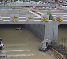 Man in central China survives 3 days in flooded garage