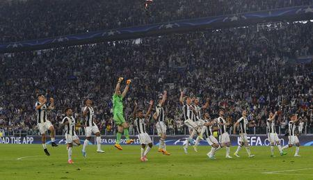 Juventus players celebrate after the match