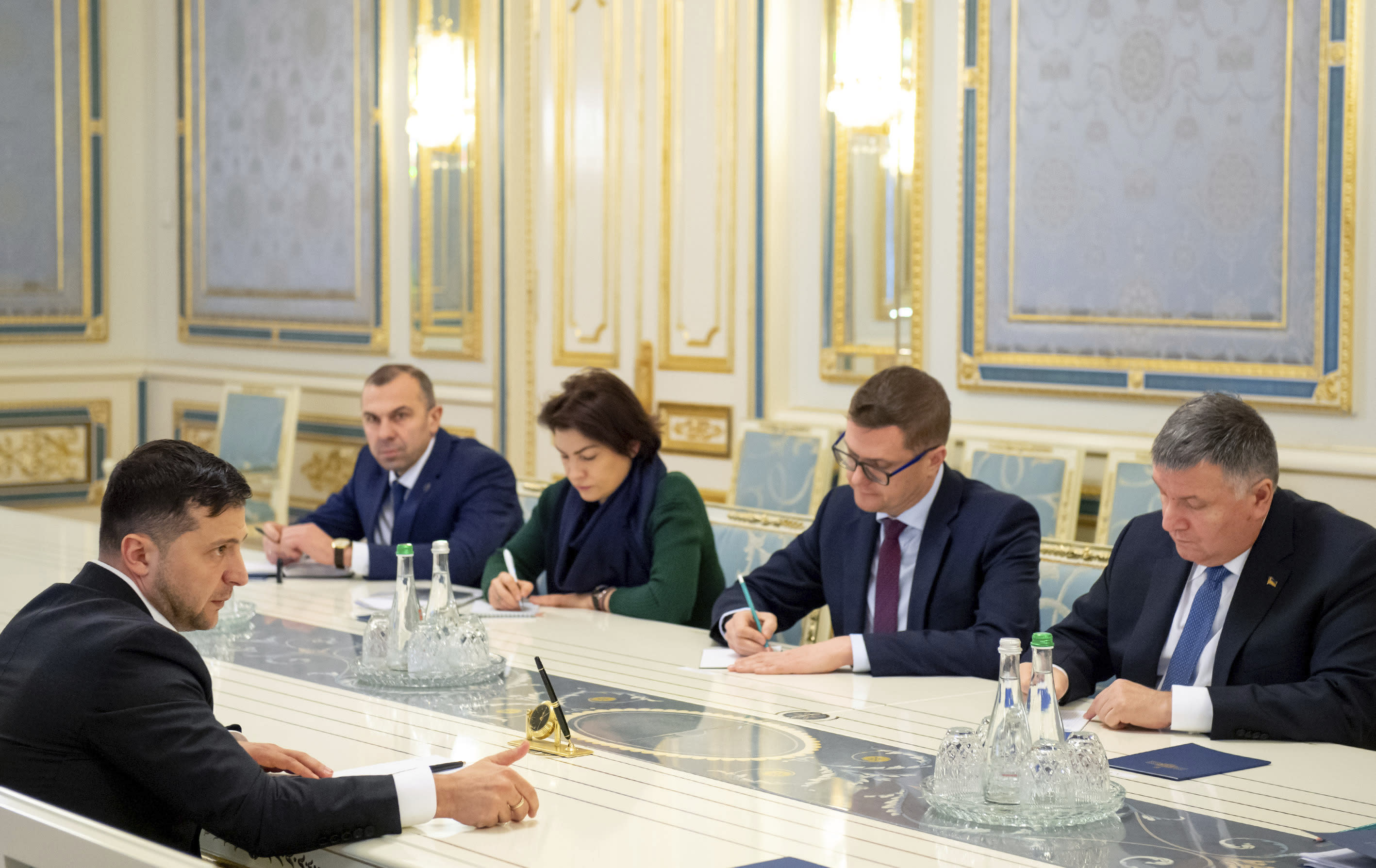 In this photo provided by the Ukrainian Presidential Press Office, Ukrainian President Volodymyr Zelenskiy, left, speaks during a meeting with cabinet members and security officials in Kyiv, Ukraine, Friday, Jan. 17, 2020. Ukraine's prime minister submitted his resignation Friday, days after he was caught on tape saying the country's president knows nothing about the economy. Zelenskiy demanded that the provenance of the tapes be investigated. (Ukrainian Presidential Press Office via AP)
