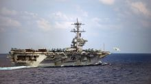 Pentagon removes captain of virus-struck aircraft carrier