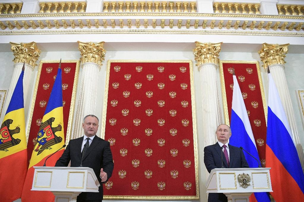 Russian President Vladimir Putin (R) and his Moldovan counterpart Igor Dodon attend a joint press conference at the Kremlin on January 17, 2017
