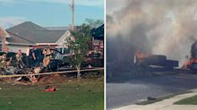 Two people killed as plane crashes into suburban neighbourhood
