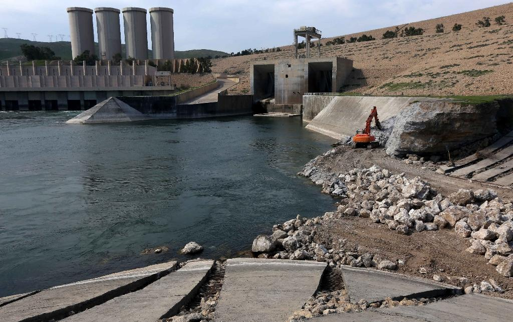 The dam in northern Iraq was built on an unstable foundation that continuously erodes, and a lapse in required maintenance after the Islamic State jihadist group briefly seized it in 2014 weakened the already flawed structure (AFP Photo/Safin Hamed)