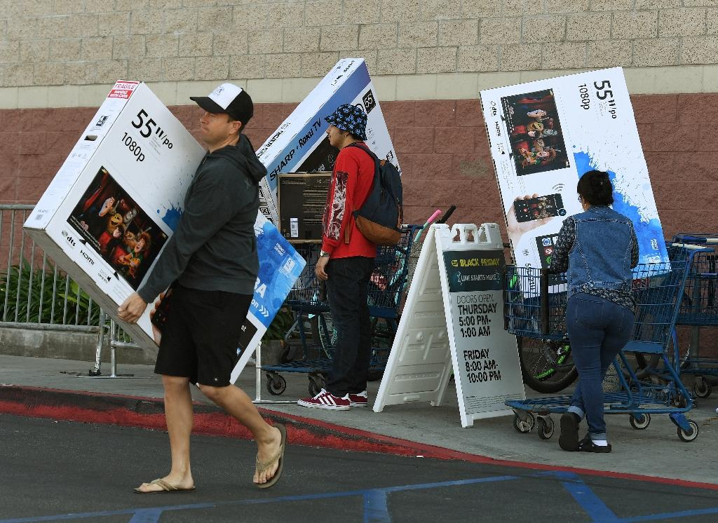 US consumers are entering the holiday season in high spirits amid optimism that the economy will continue to expand, the Conference Board says (AFP Photo/Mark RALSTON)