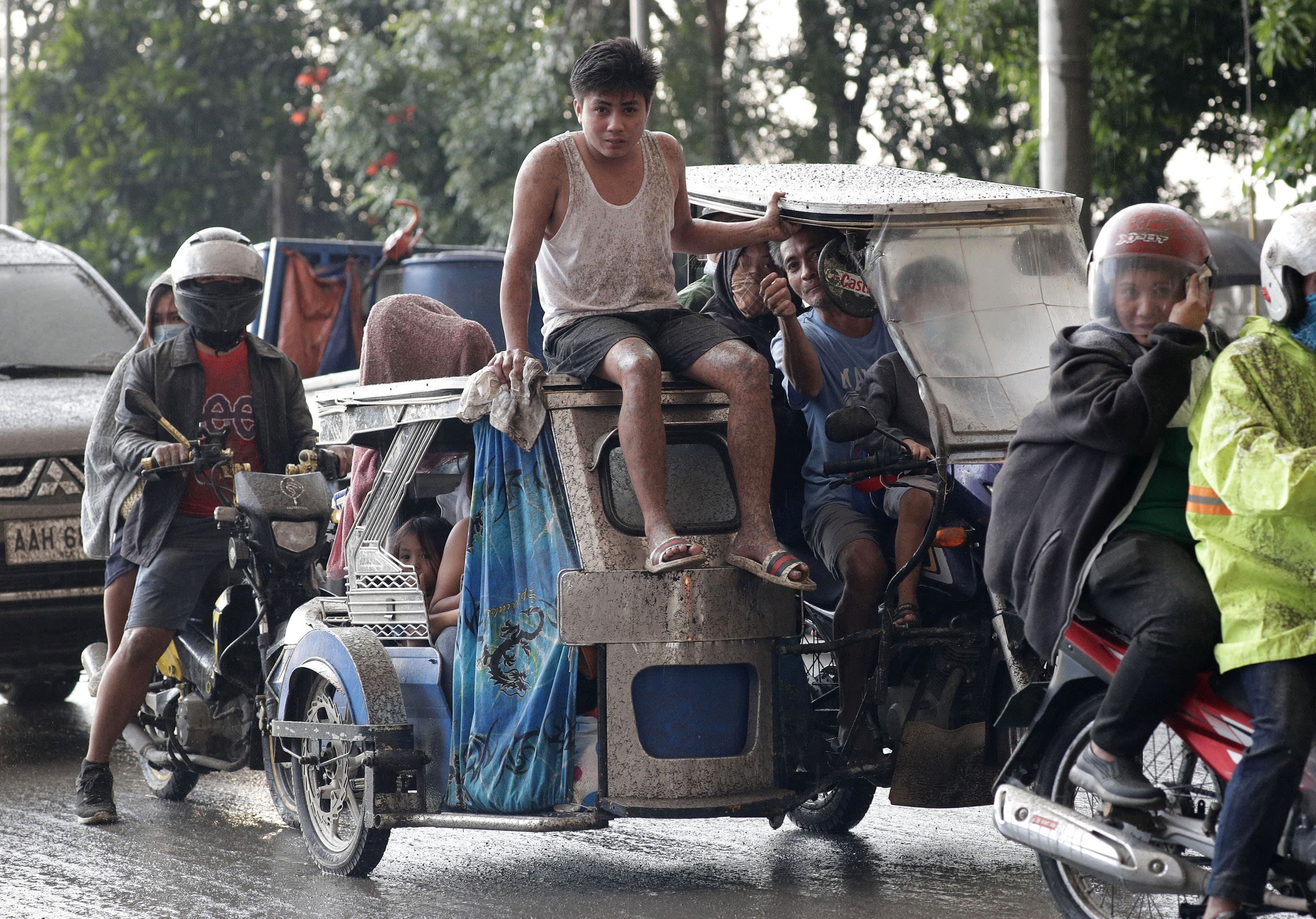 In this Jan. 12, 2020, photo, residents evacuate as Taal Volcano erupts in Tagaytay, Cavite province, outside Manila, Philippines. (AP Photo/Aaron Favila)