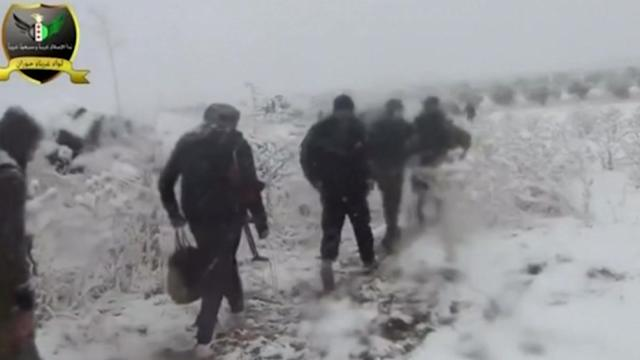 Rebels fight through Syrian snow