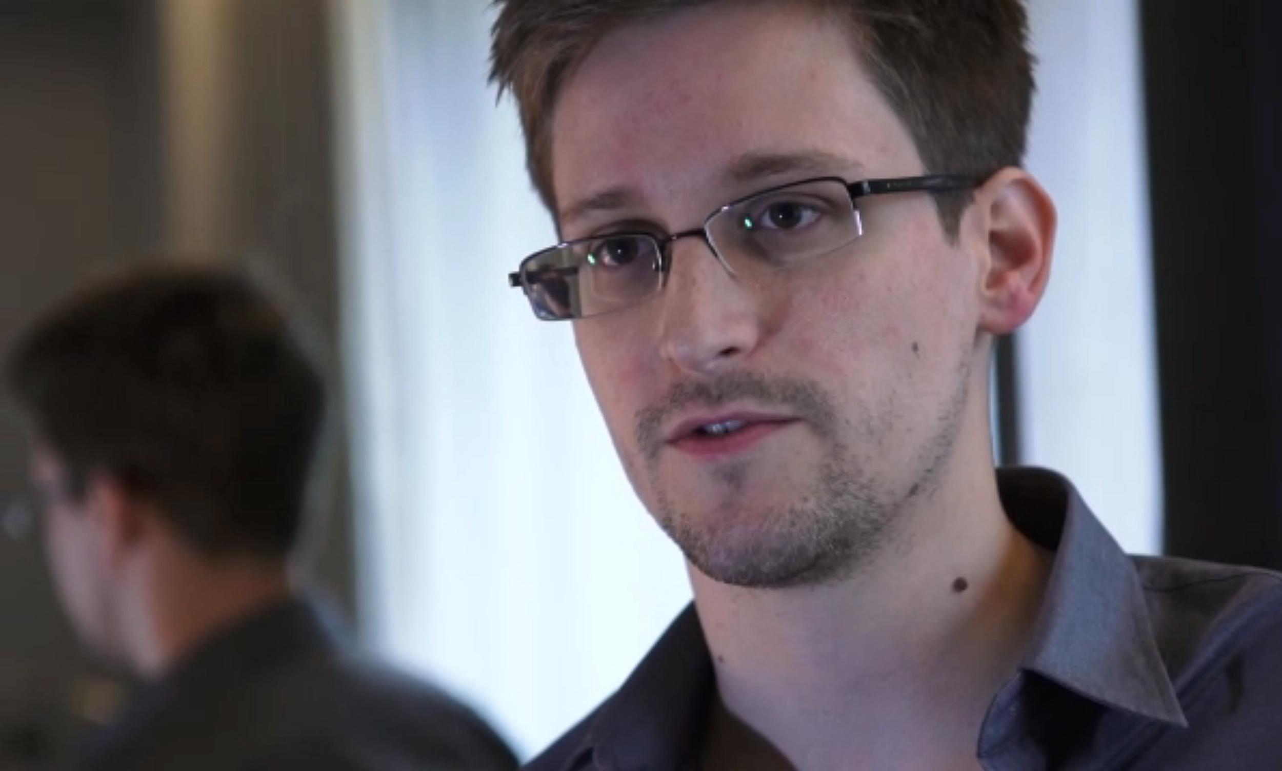 Edward Snowden, the fugitive US intelligence agent, was granted political asylum by Russia after he flew in from Hong Kong in June 2013 (AFP Photo/The Guardian)