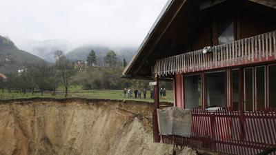 Raw: Giant Sinkhole Swallows Bosnian Pond