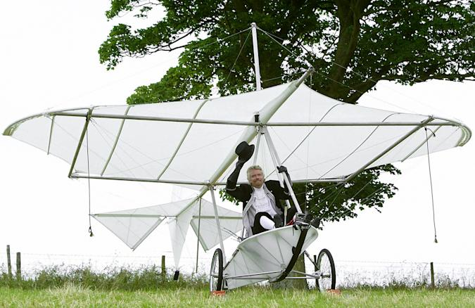 Sir Richard Branson in a replica of Cayley's monoplane glider on the 150th anniversary of the worlds first manned-fight, at Brompton Dale, near Scarborough.   (Photo by Martin Rickett - PA Images/PA Images via Getty Images)