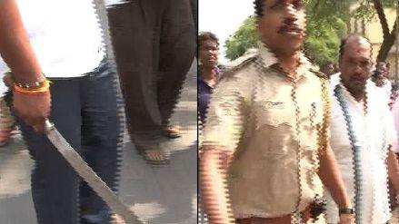 K'taka polls: Cong Party workers brandish weapons