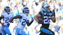 Christian McCaffrey runs in three touchdowns as Panthers beat the Titans