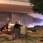 Protesters' Fire Bombs Met With Police Water Cannon in Hong Kong Clash