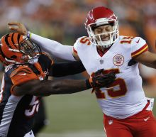 3 Chiefs throw TD passes in 30-12 win over Bengals