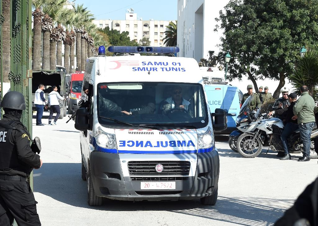 Ambulance evacuates victims of the gun attack on the Tunisian capital's Bardo Museum in March 2015 (AFP Photo/FETHI BELAID)
