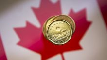 Loonie little changed, pares earlier drop as oil price rallies