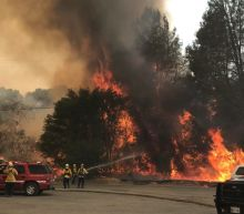 Wind-driven wildfires threatened homes in Northern California