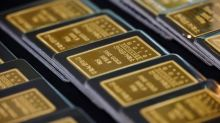 Gold eases as yields tick up, but set for best week in five