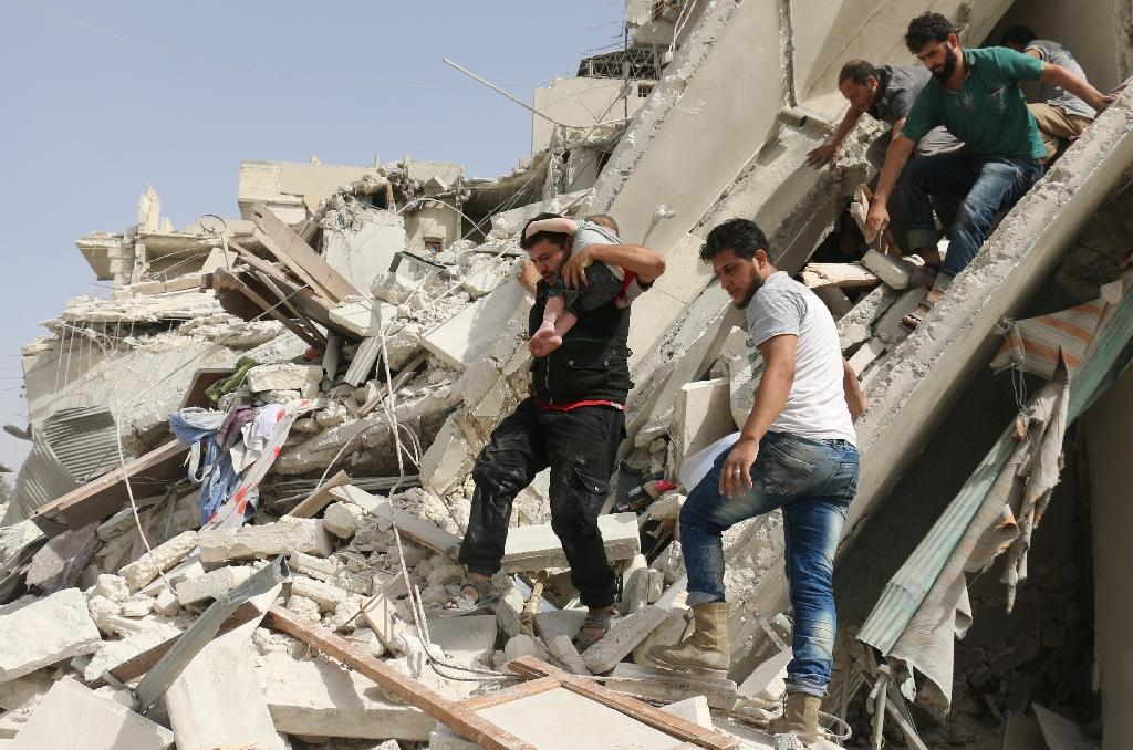 Syrian men remove a baby from the rubble of a destroyed building following a reported air strike in the Qatarji neighbourhood of the northern city of Aleppo on September 21, 2016 (AFP Photo/Ameer Alhalbi)