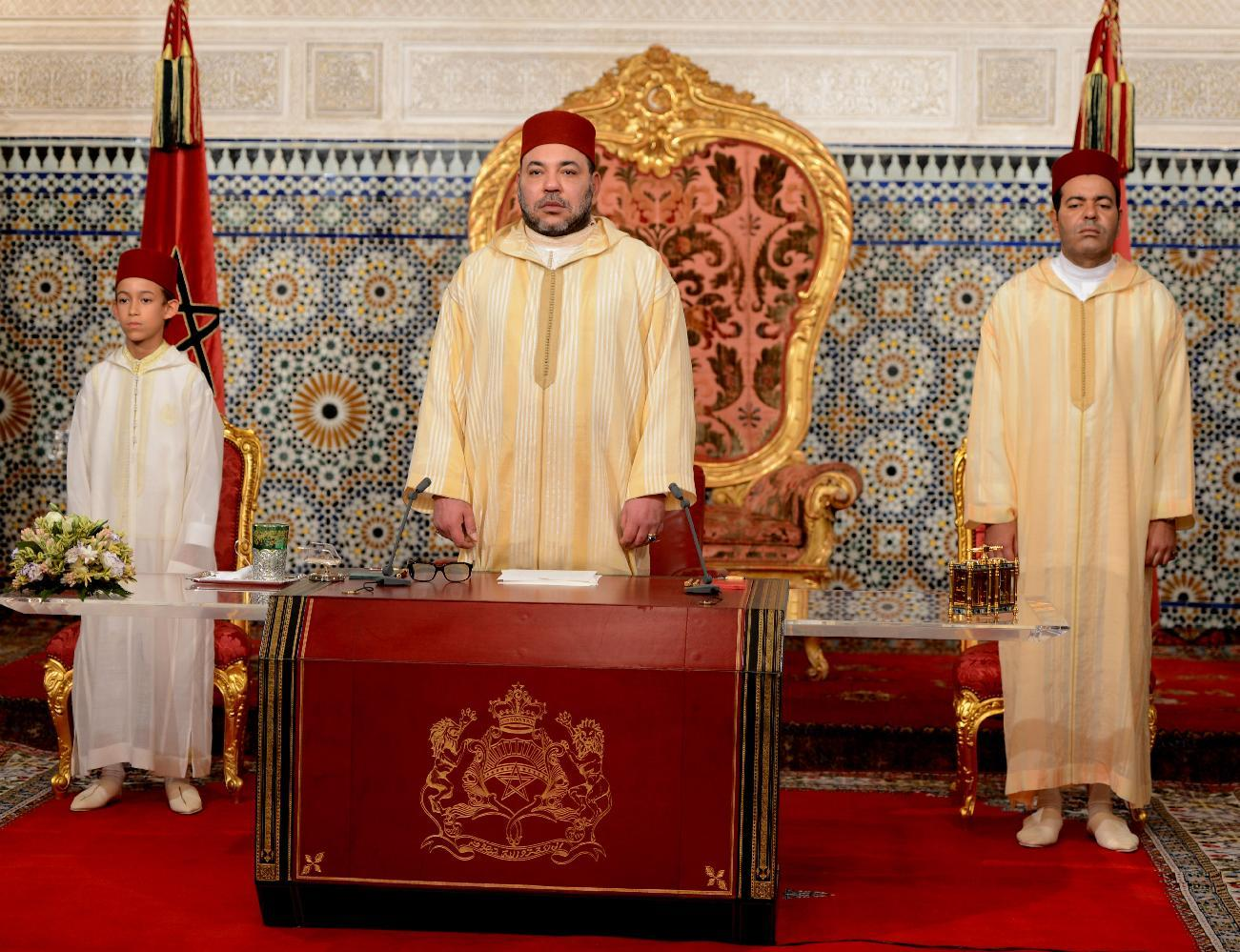 A handout picture released by the Moroccan Royal Palace shows Morocco's King Mohammed VI (C) delivering a speech marking the 15th anniversary of his coronation, on July 30, 2014, in Rabat