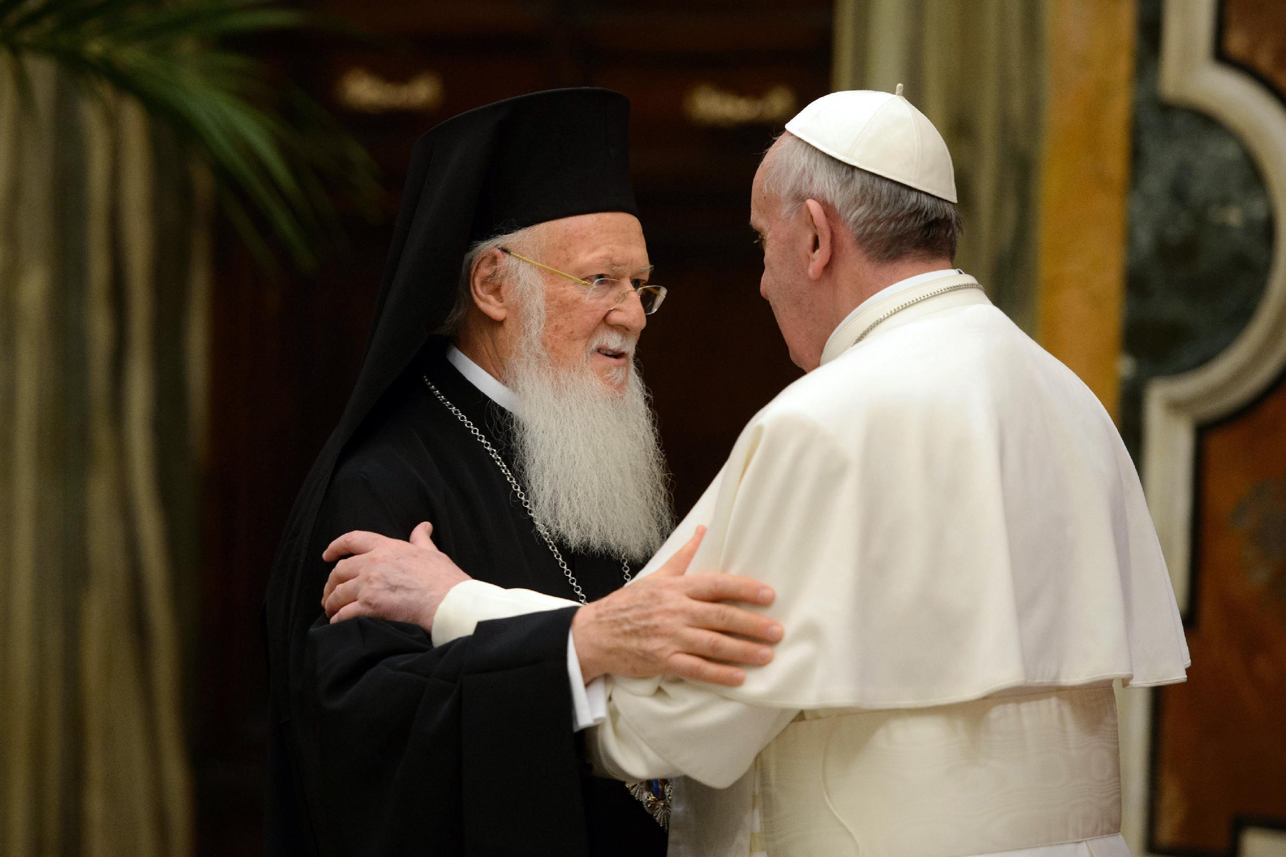 FILE- In this March 20, 2013, file photo provided by the Vatican paper L' Osservatore Romano, Pope Francis, right, meets Bartholomew I, the first ecumenical patriarch to attend the installation of a Pope since the Catholic and Orthodox church split nearly 1,000 years ago, at the Vatican. Bartholomew I, spiritual leader of 250 million Orthodox Christians, said a meeting with Pope Francis in Jerusalem in May 2014, will help move the two churches closer to ending their nearly one-thousand-year divide. (AP Photo/Osservatore Romano, File)