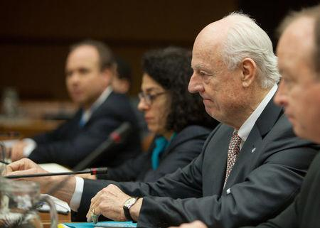 UN envoy Staffan de Mistura (C) looks on before the start of talks on Syria in Vienna