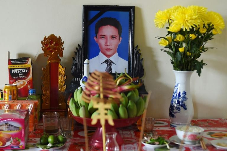 A portrait of 30-year old Le Van Ha is displayed at his home (AFP Photo/NHAC NGUYEN)