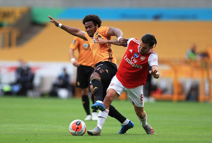 WOLVERHAMPTON, ENGLAND - JULY 04: Adama Traore of Wolverhampton Wanderers and Dani Ceballos of Arsenal battle for the ball during the Premier League match between Wolverhampton Wanderers and Arsenal FC at Molineux on July 04, 2020 in Wolverhampton, England. Football Stadiums around Europe remain empty due to the Coronavirus Pandemic as Government social distancing laws prohibit fans inside venues resulting in all fixtures being played behind closed doors. (Photo by Mike Egerton/Pool via Getty Images)