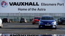 May disappointed at PSA's move to cut jobs at Vauxhall factory