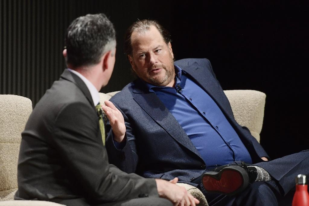 Salesforce head Marc Benioff (R) says his fellow billionaires are hoarding money and don't want to help the homeless (AFP Photo/Matt Winkelmeyer)