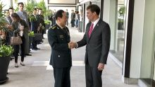 """China urges US to """"stop flexing muscles"""" in South China Sea"""