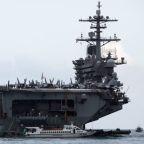 Onshore quarantine of U.S. aircraft carrier sailors begins on Guam