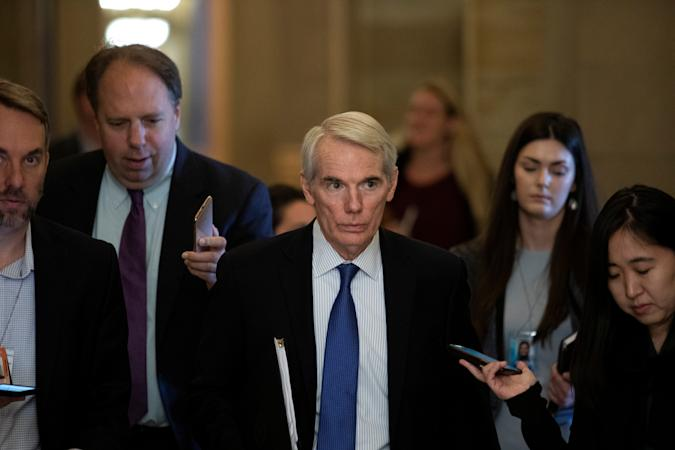 Senator Rob Portman (R-OH) walks along news reporters before attending a vote, on Capitol Hill in Washington, U.S., June 23, 2021.  REUTERS/Tom Brenner