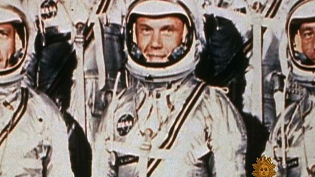Almanac: John Glenn goes into orbit