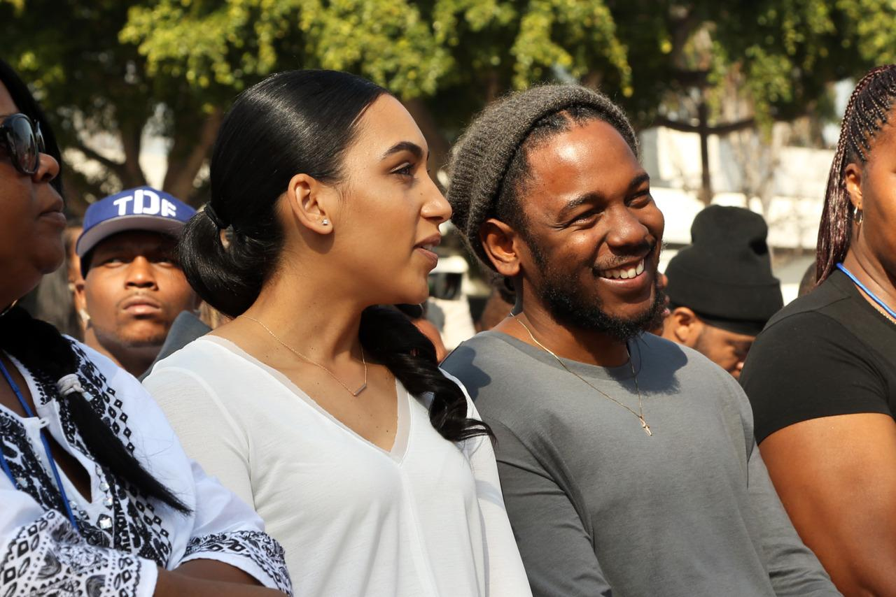 <p>Lamar receives the Key to the City on Saturday, February 13, in Compton. His longtime girlfriend, Whitney Alford, is at left. (Photo by Johnny Nunez/Getty Images)</p>
