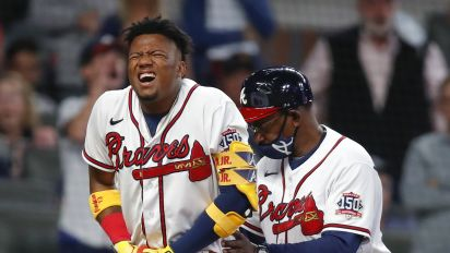 Braves' Acuna leaves game after taking pitch on hand