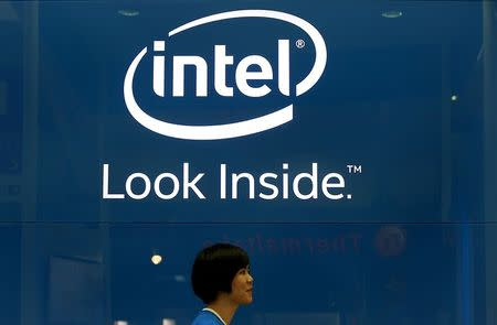 An employee walks past an Intel logo during the 2014 Computex exhibition at the TWTC Nangang exhibition hall in Taipei