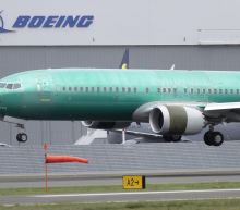 Shadow of 2 deadly crashes hangs over Boeing's 1Q earnings