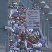 Bernie Sanders supporters march across Ben Franklin Bridge