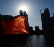 China expels Wall Street Journal reporters over 'racist' headline