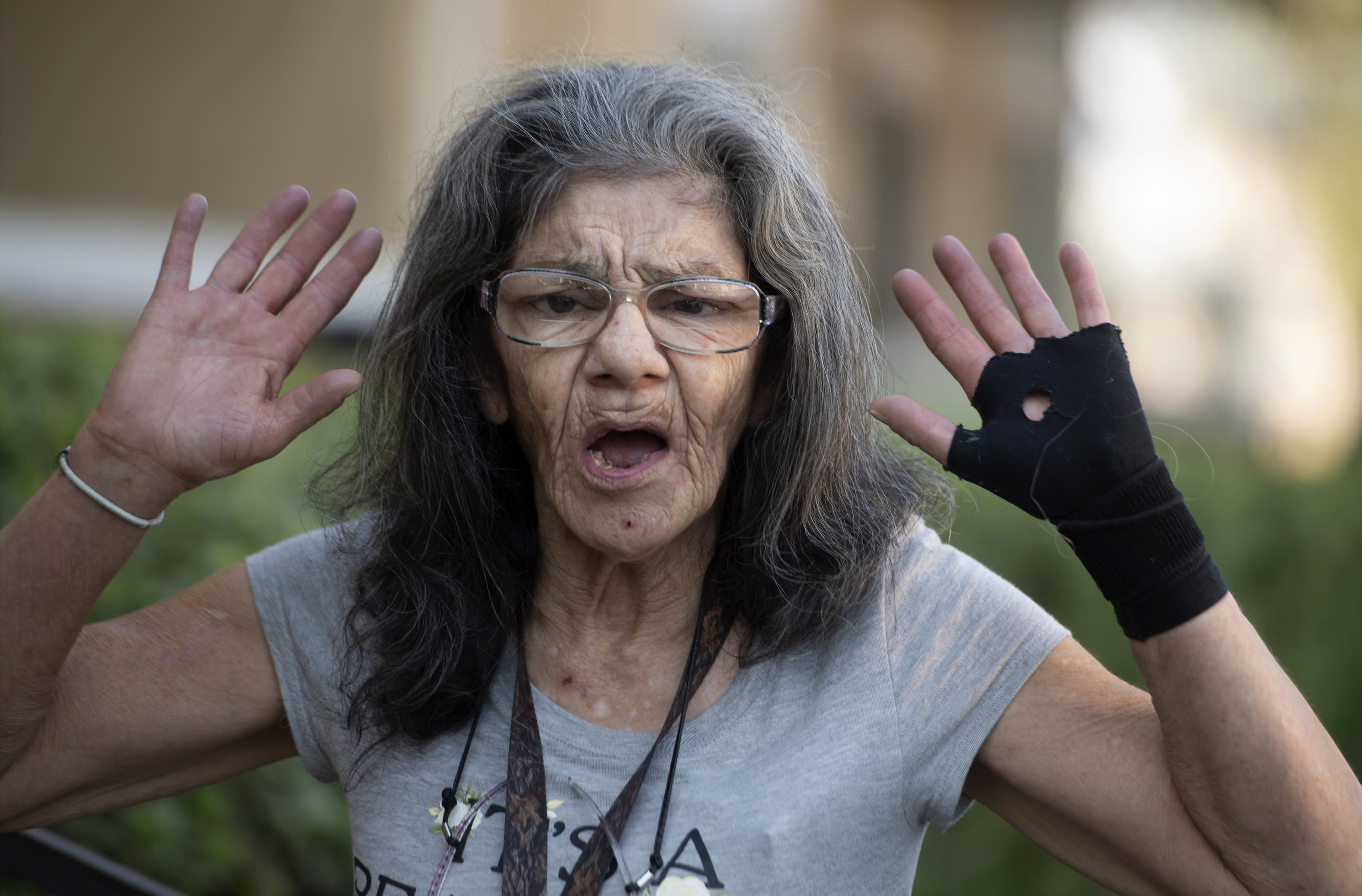 """""""I'm the master of assassination,"""" Lorenza Marrujo, 67, says when asked about her martial arts skills at her Fontana, Calif., apartment home Wednesday, Sept. 30, 2020. Marrujo, who likes to be called """"Lady Ninja"""" and has a black belt in ju jitsu, said she was in her third-floor apartment Monday when she heard screams coming from a neighbor's apartment and went to investigate. There, she said, she found another neighbor attacking her 87-year-old friend, Elizabeth McCray. Marrujo came to her rescue. (Cindy Yamanaka/The Orange County Register/SCNG via AP)"""
