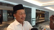 Calling Umno a 'sinking ship', Sabah division chief says he wants out