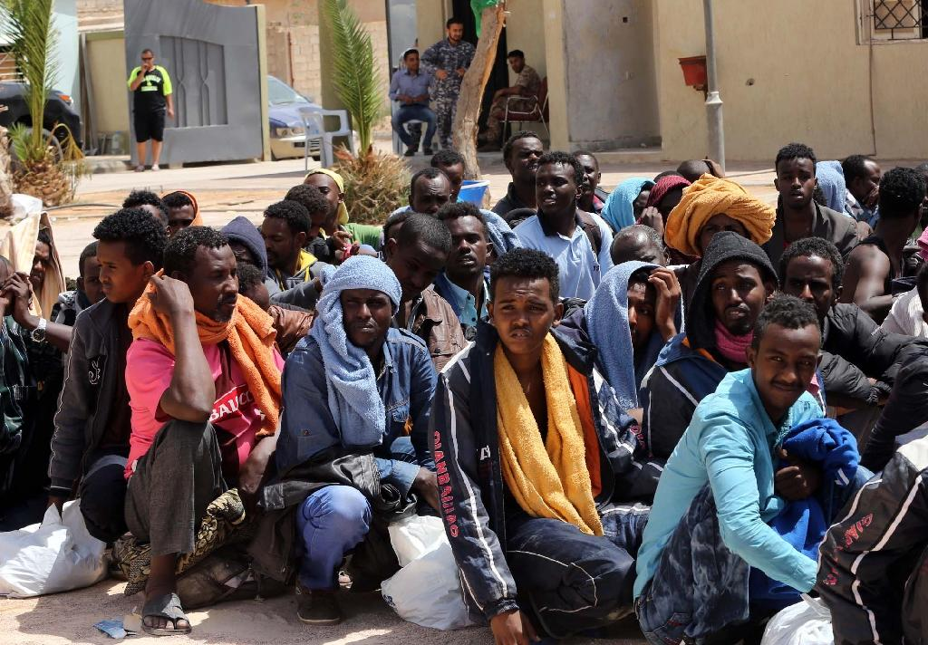 Migrants from sub-Saharan Africa sit at a center for illegal migrants in the al-Karem district of the Libyan port city of Misrata on May 9, 2015 (AFP Photo/Mahmud Turkia)