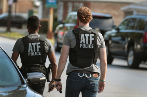 ATF police investigate a shooting at a Chicago elementary school in which two girls were hit by bullets from a car.